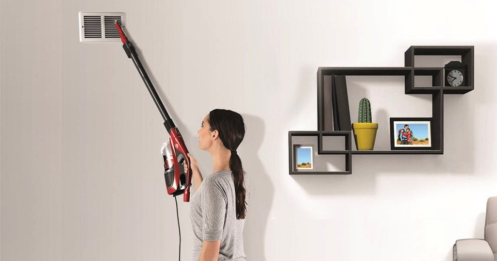 woman using a Dirt Devil Power Stick 4-in-1 Corded Stick Vacuum
