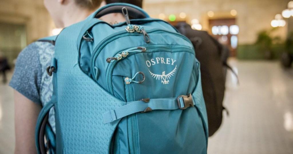 woman wearing Osprey Porter 30 Travel Pack