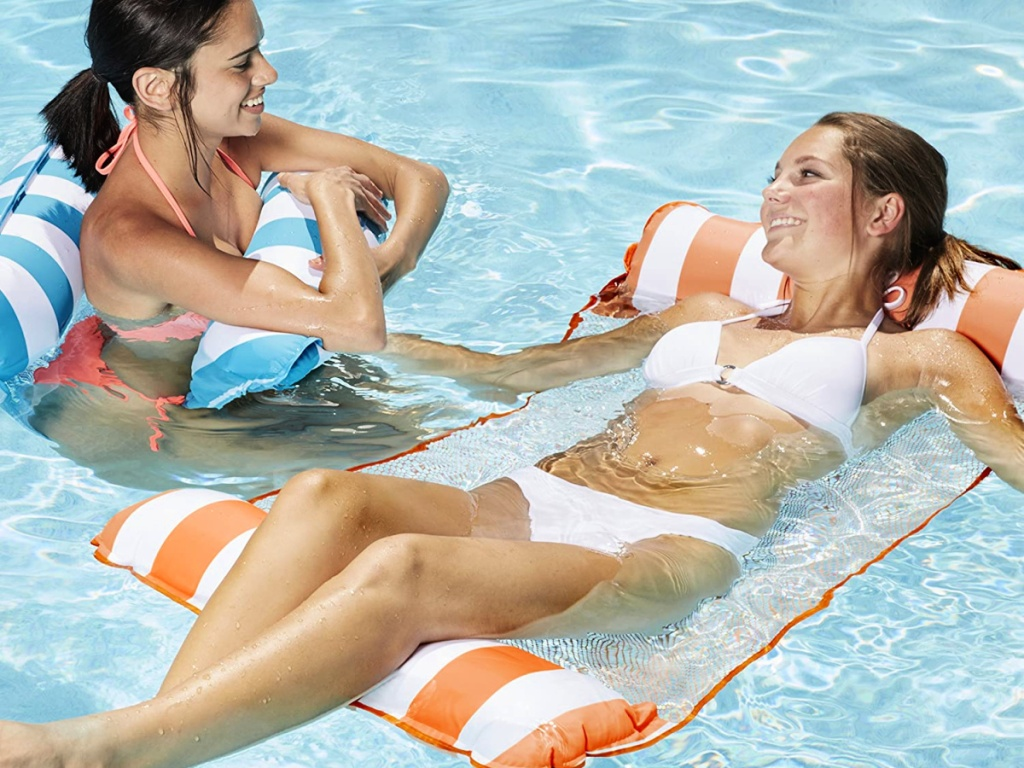 women lounging on pool floats