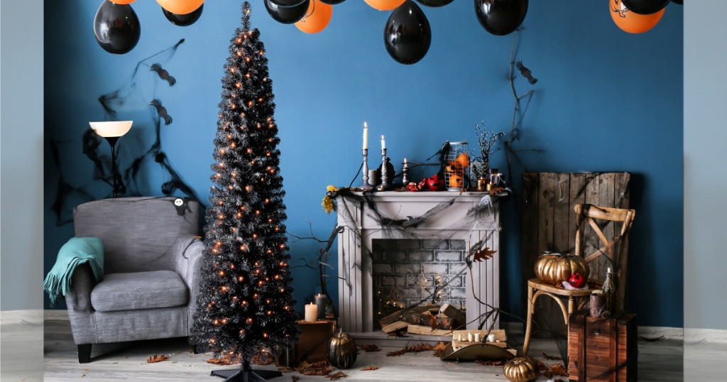 livingroom with halloween decor and 6ft. Pre-Lit Shiny Black Pencil Tree, Clear Lights by Ashland