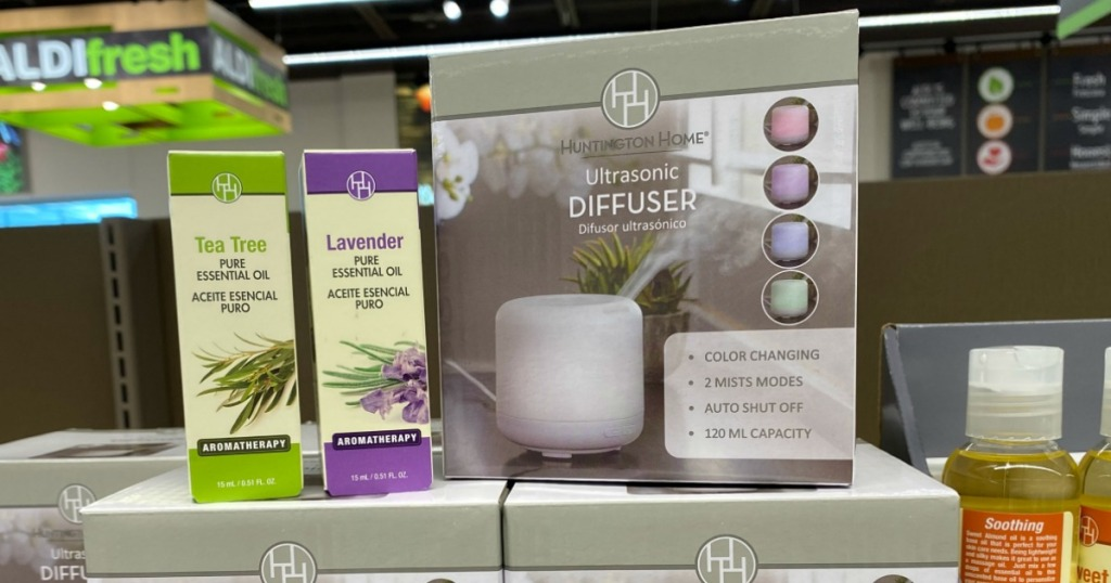 essential oils next to a diffuser