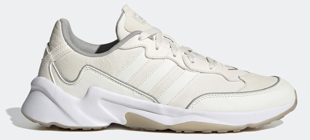 cream colored sneaker with three white adidas stripes on side and white rubber sole