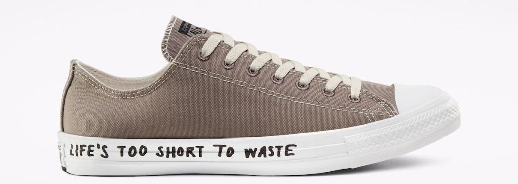 brown converse with writing on the sole