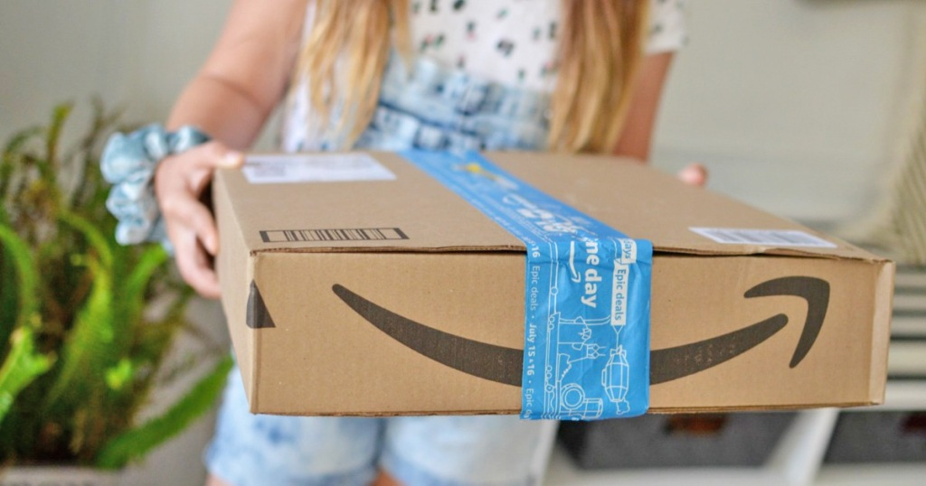 woman holding out an amazon box with blue printed packaging tape on it