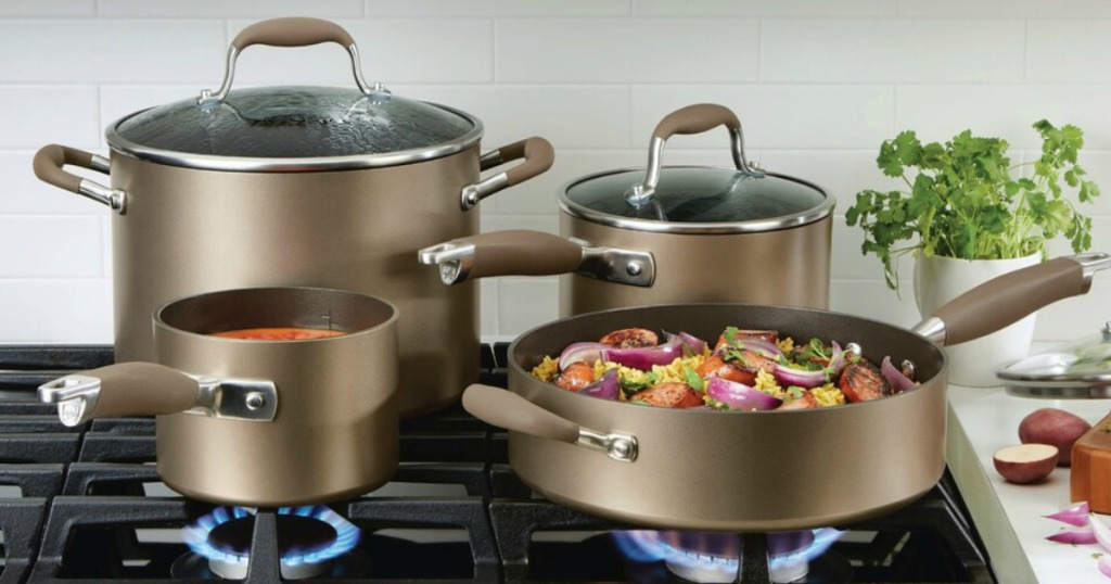 cookware set on stove with food in it