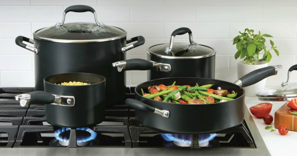 cookware on a stove with food cooking