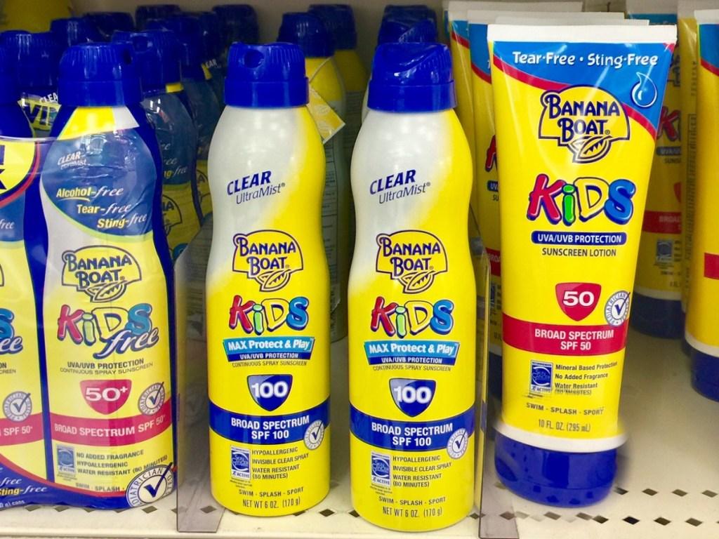 multiple bottles of kids banana boat sunscreen on store shelf
