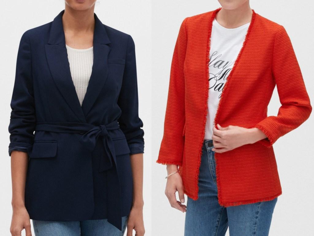 2 women standing next to each other wearing a navy blazer and a orange blazer
