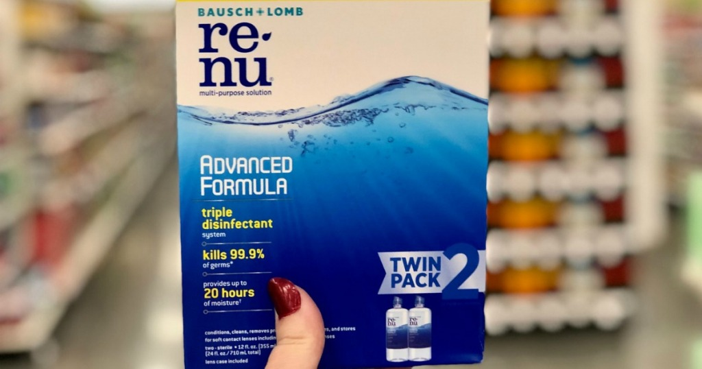 Twin pack of contact solution in package in hand