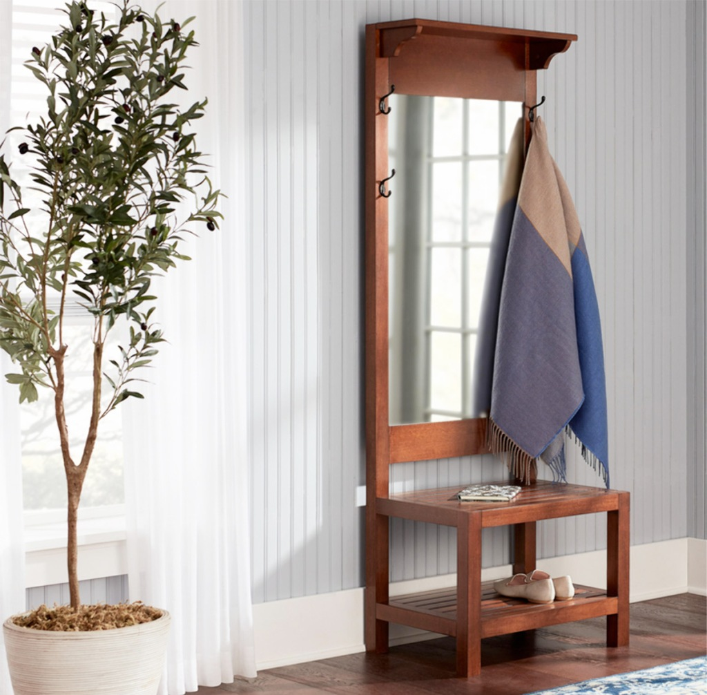 brown wooden hall tree with mirror and scarf hanging from hook