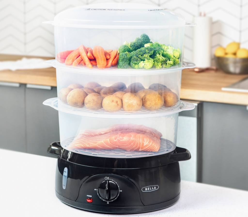 food steamer with different foods in it