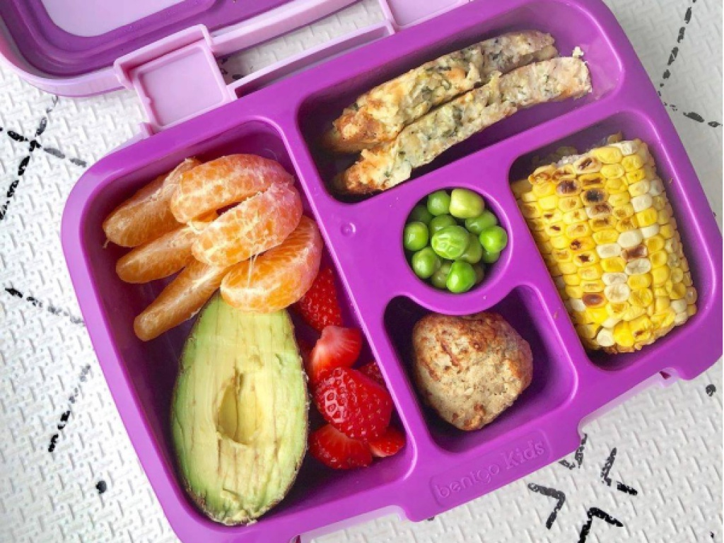 kids purple lunch box filled with food