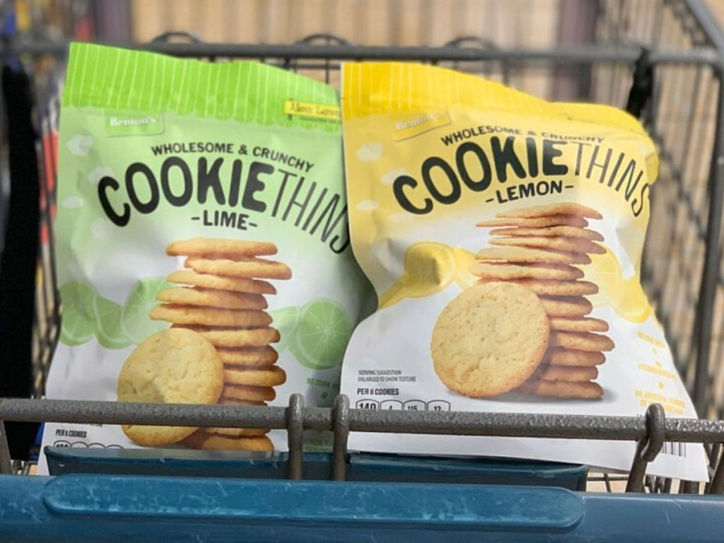 two bags of cookie thins in the front of a shopping cart