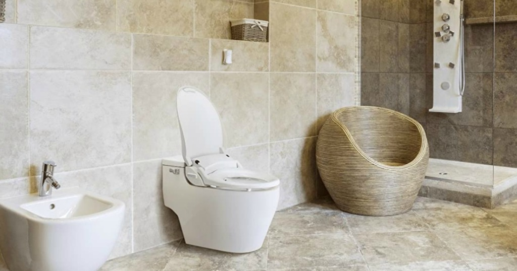 bathroom with sink, bidet and chair