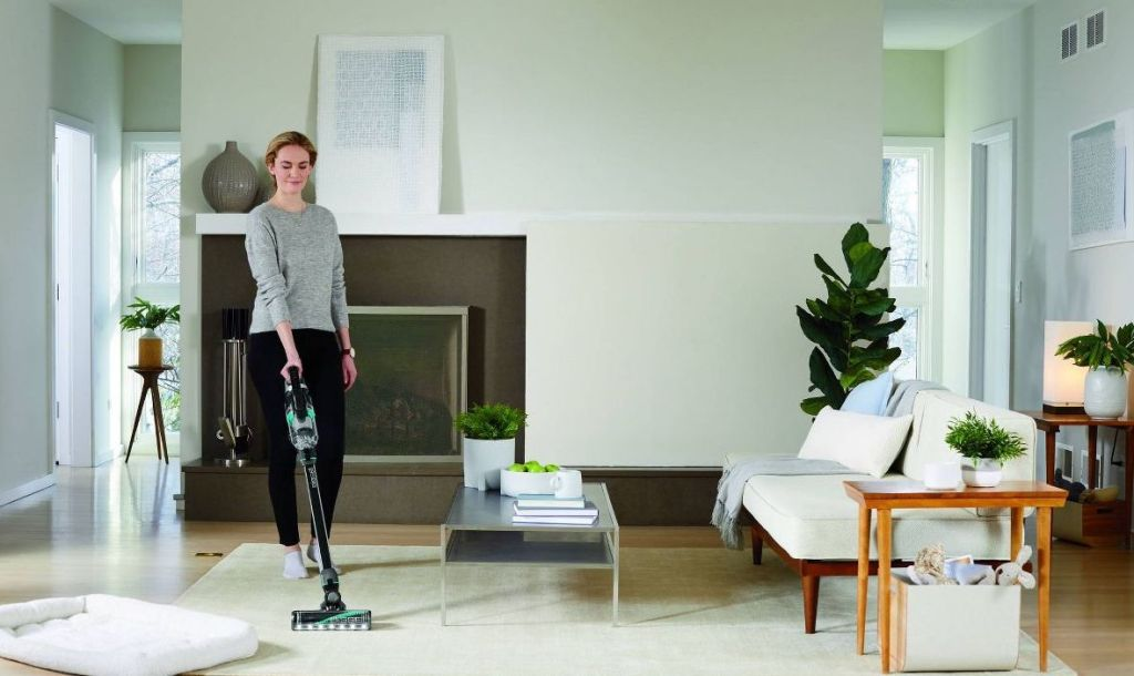 woman vacuuming a living room