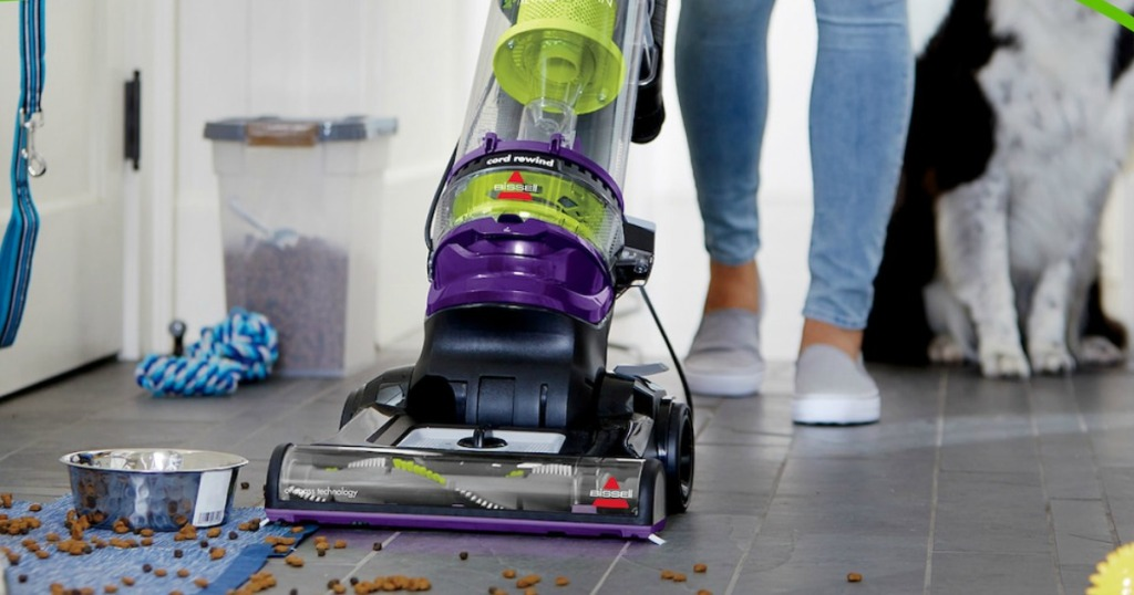 person using a vacuum