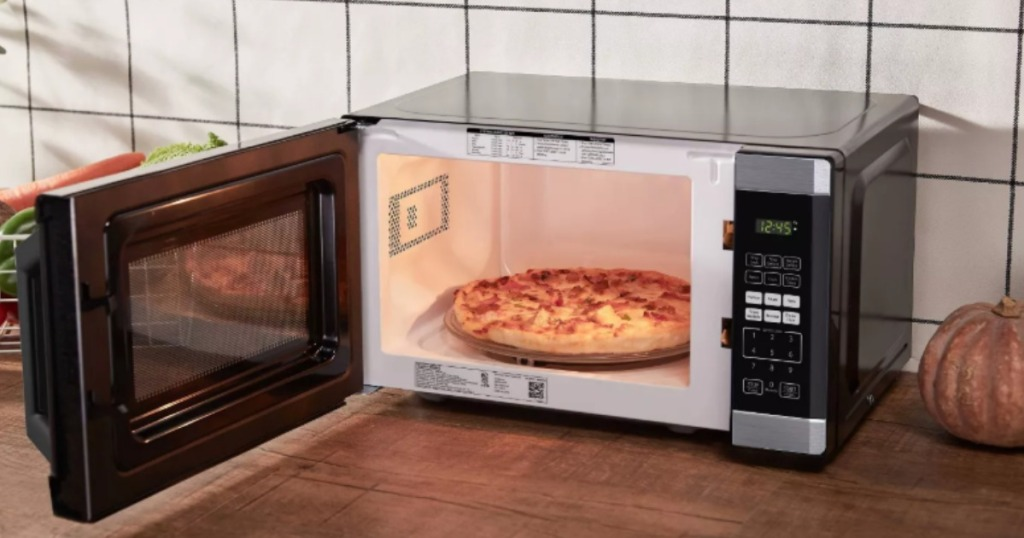 microwave with pizza inside