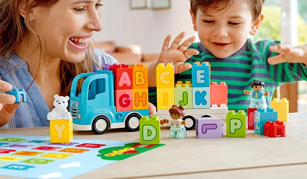 LEGO duplo my first alphabet train boy and mom playing