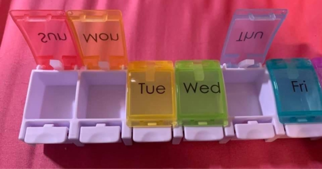 pill organizer opened with pink background