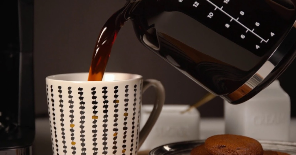 bella coffee maker pouring coffee into mug