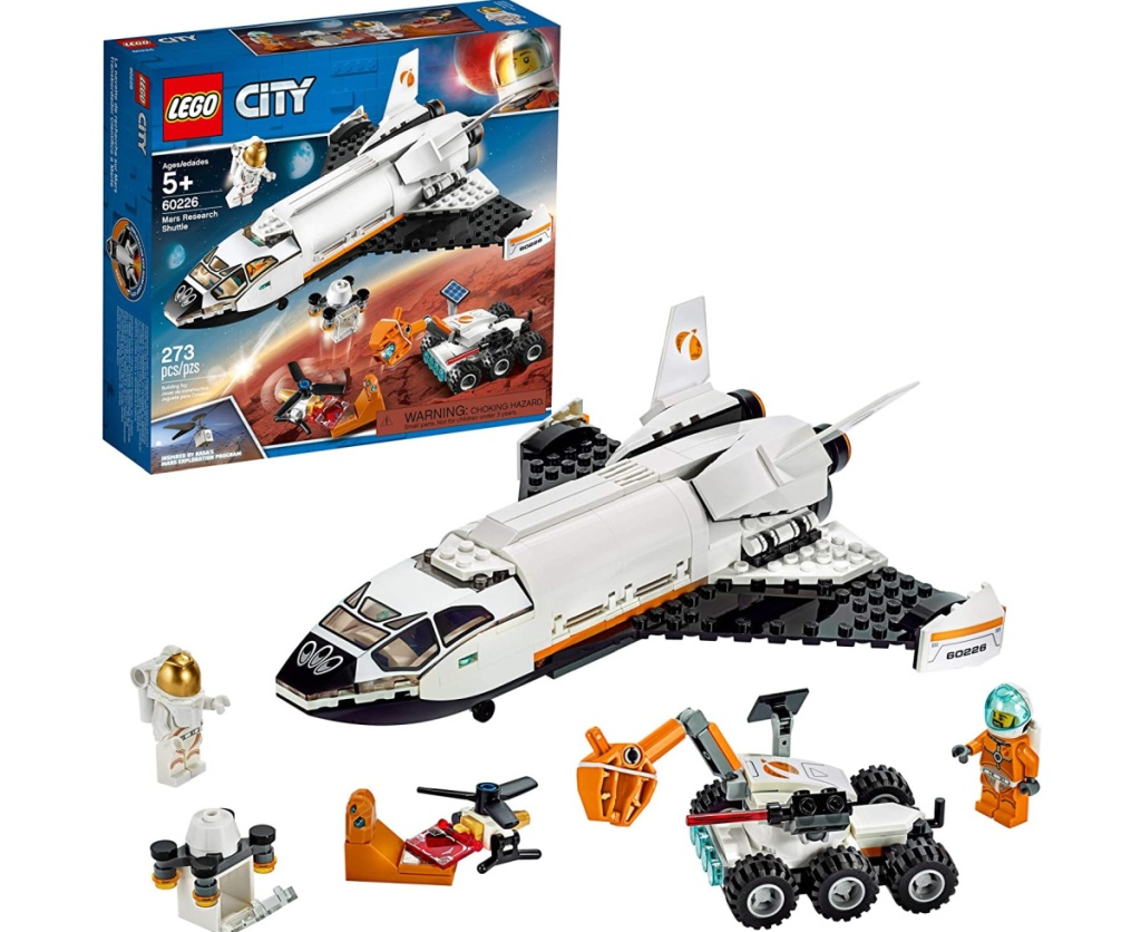 lego city space shuttle assembled next to box