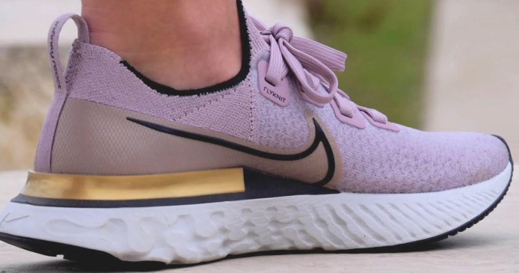 nike womens flyknit infinity react shoe metallic pink on feet