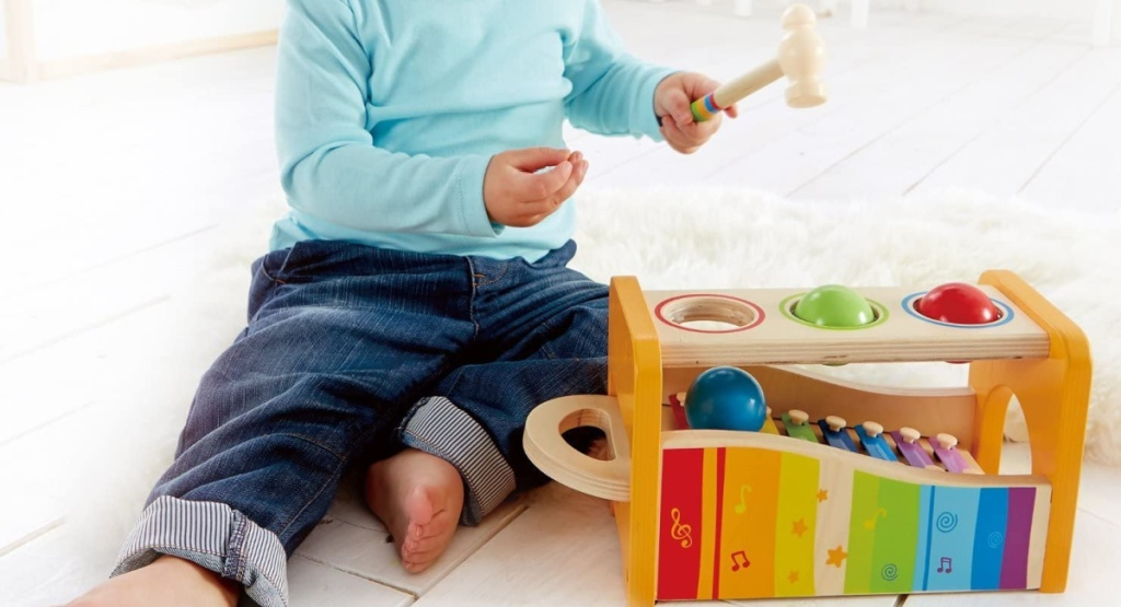hape pound and tap bench with little boy sitting