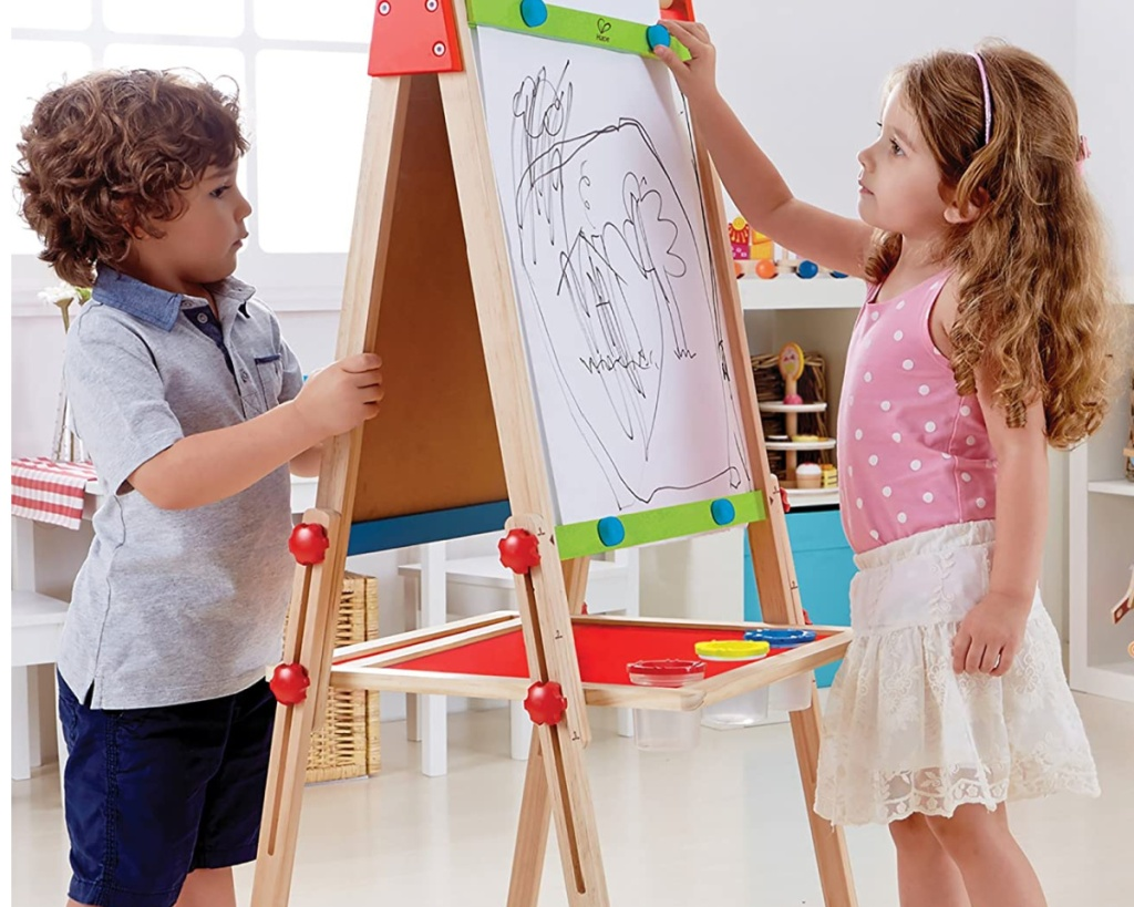 hape all in one wooden easel two kids on each side