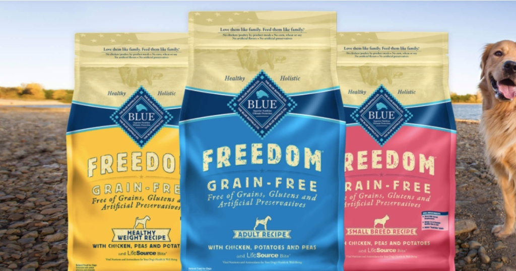 three flavors of dog food with dog and outdoor scenery in background