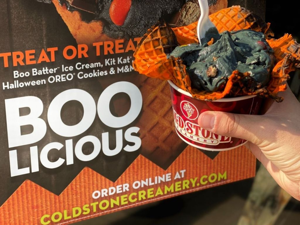 Hand holding up Cold Stone Creamery Boo Batter Ice Cream in Waffle Bowl Cup