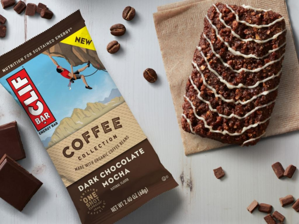 chocolate mocha energy bars in package and one out of package on table with chocolate and espresso beans on table