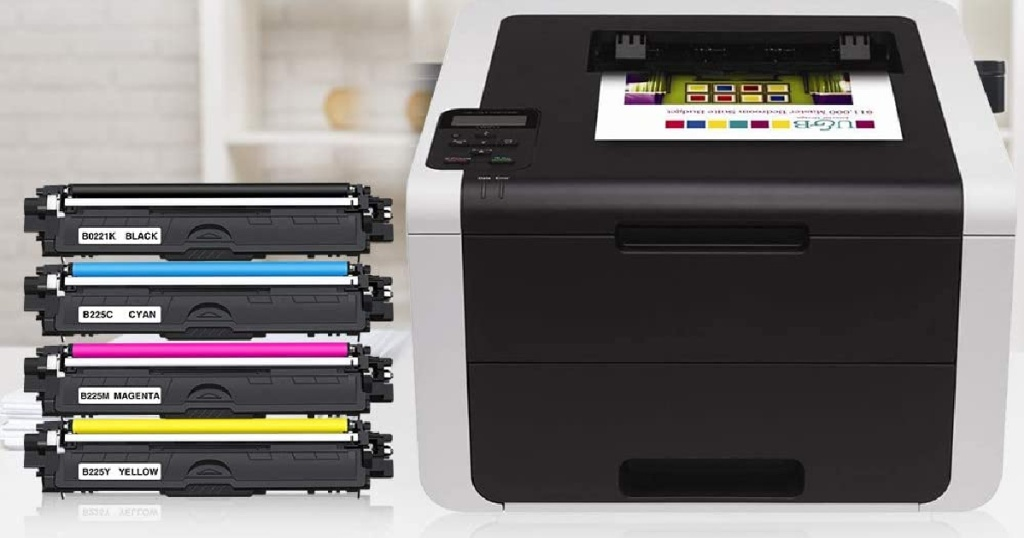 four ink cartridges sitting by printer