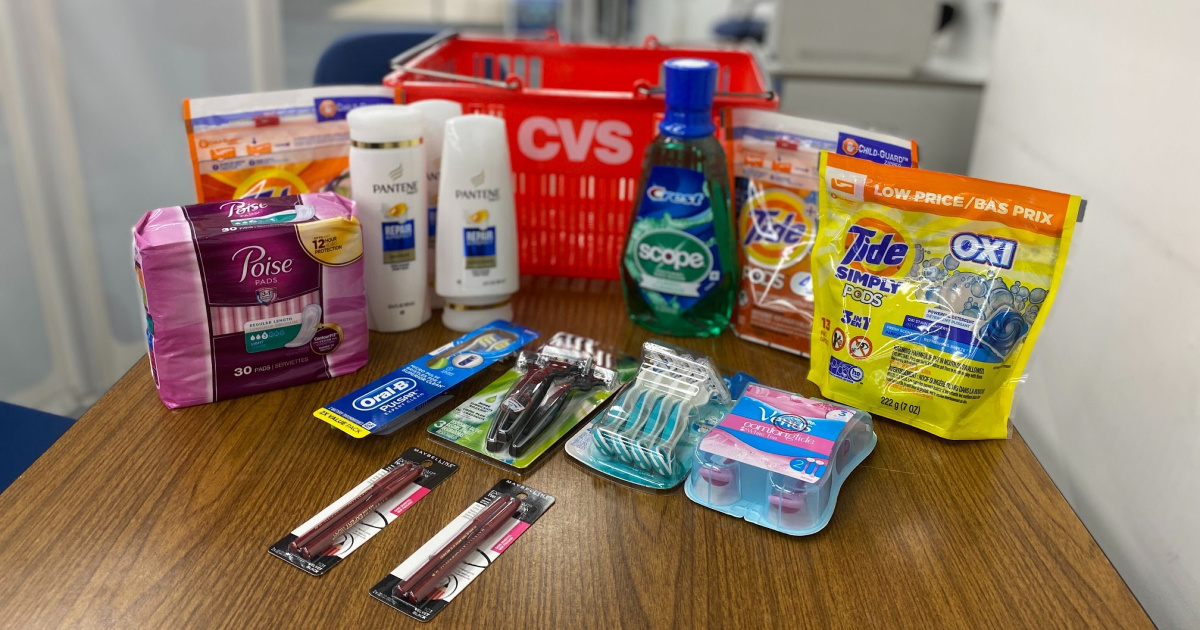 cvs basket with poise, toothbrushes, tide, scope, pantene, and razors on counter top