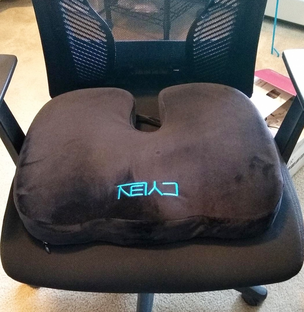 black mesh office chair with a black memory foam seat cushion on it