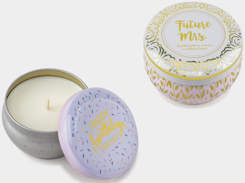 two tins filled with candles