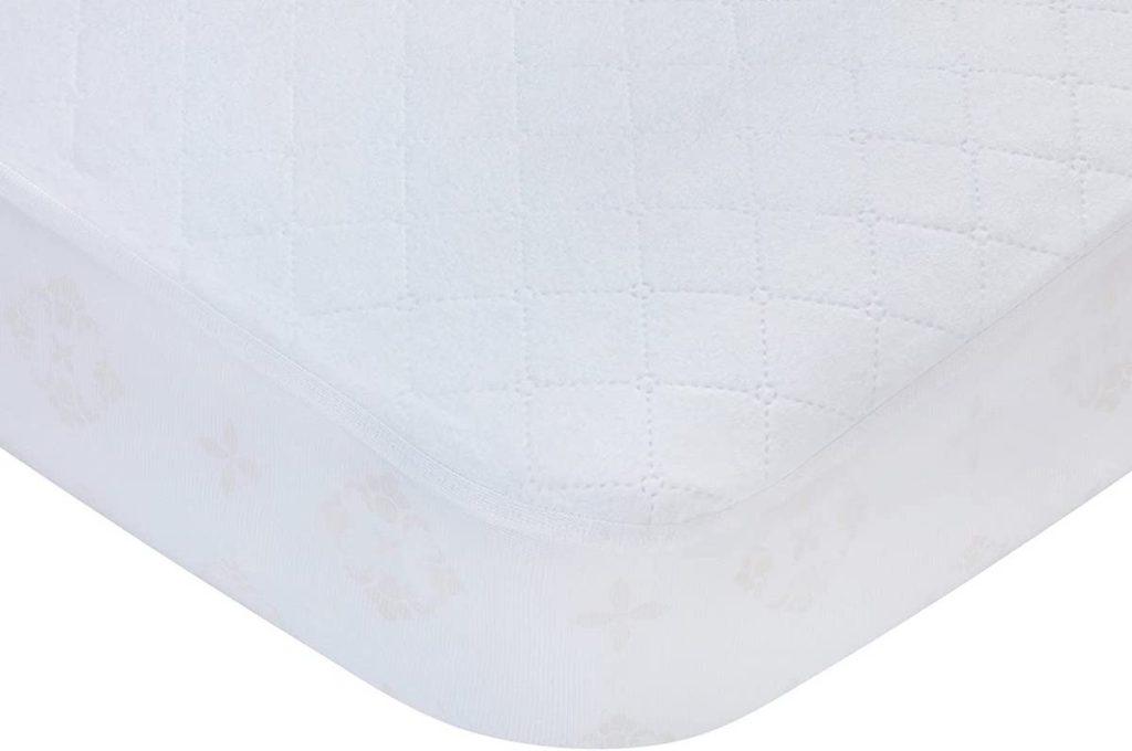 crib mattress with a pad on it