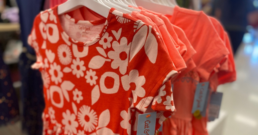 girls coral dresses hanging in store