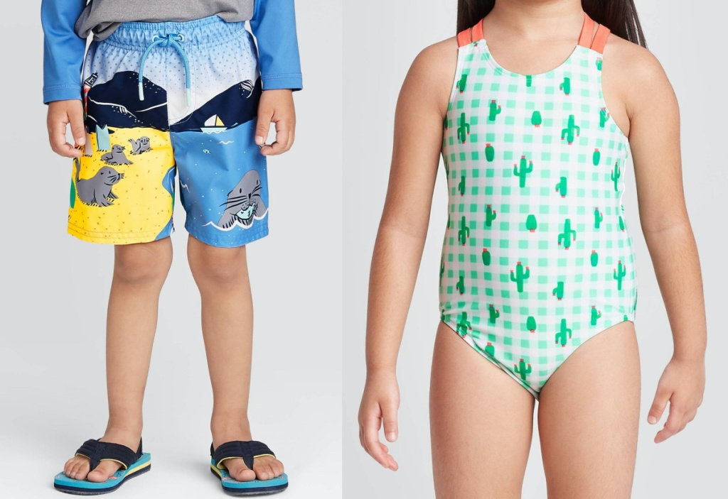 boy in swimming trunks and sandals and girl in green cactus one piece swimsuit
