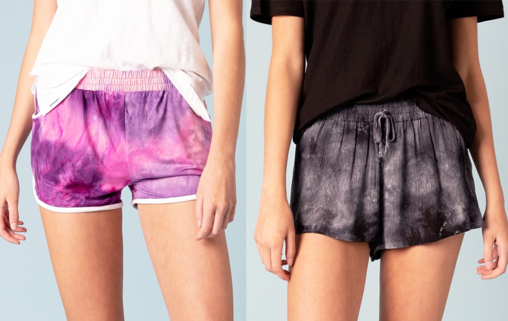 two women modeling pink and purple tie dye shorts and black tie dye shorts