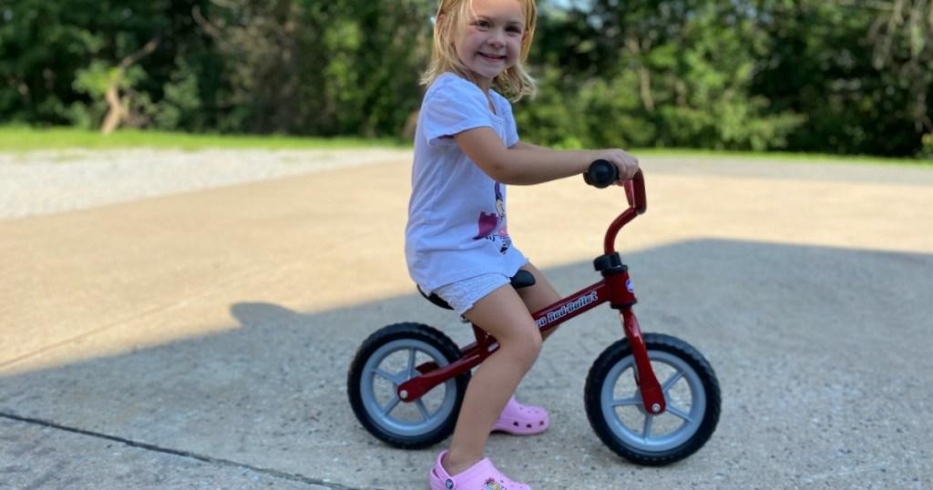 girl riding a Chicco Balance Bike