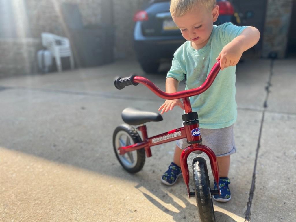 boy with a balance bike