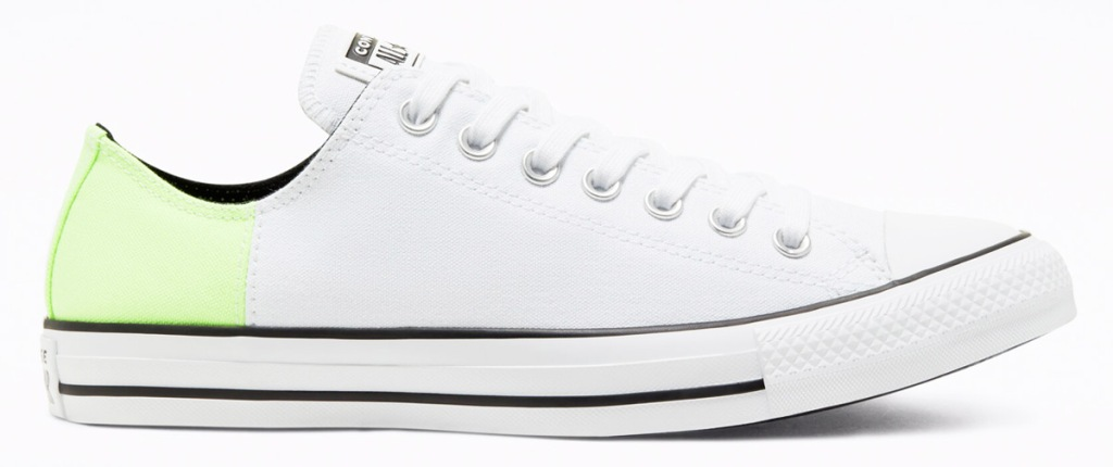 white canvas converse shoe with lime green heel and with white rubber toe