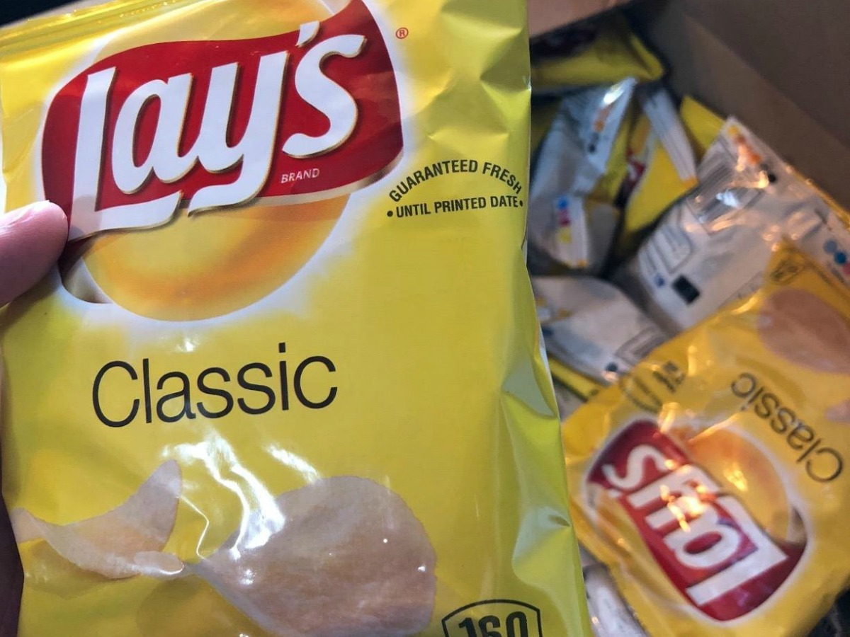 Small bag of Lay's potato chips in hand