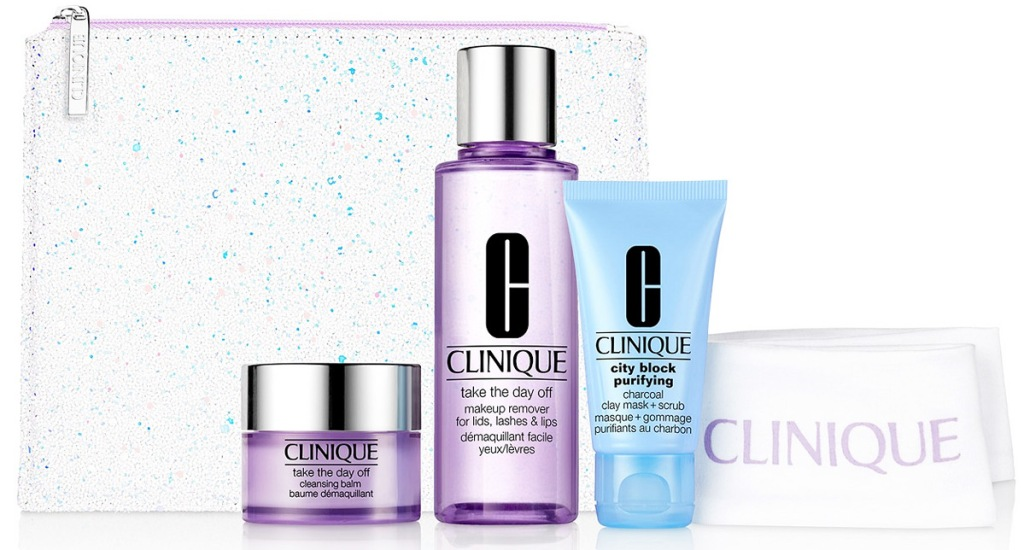 three clinique skincare products with white clinique headband and sparkly cosmetics bag