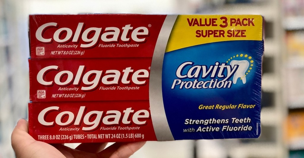 hand holding a Colgate Cavity Protection Multipack