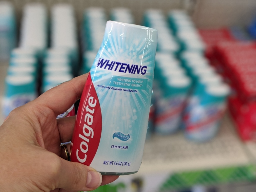 hand holding colgate whitening toothpastes