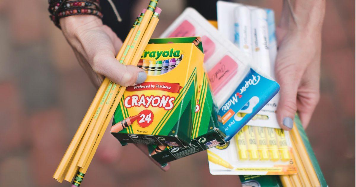 woman holding school supplies