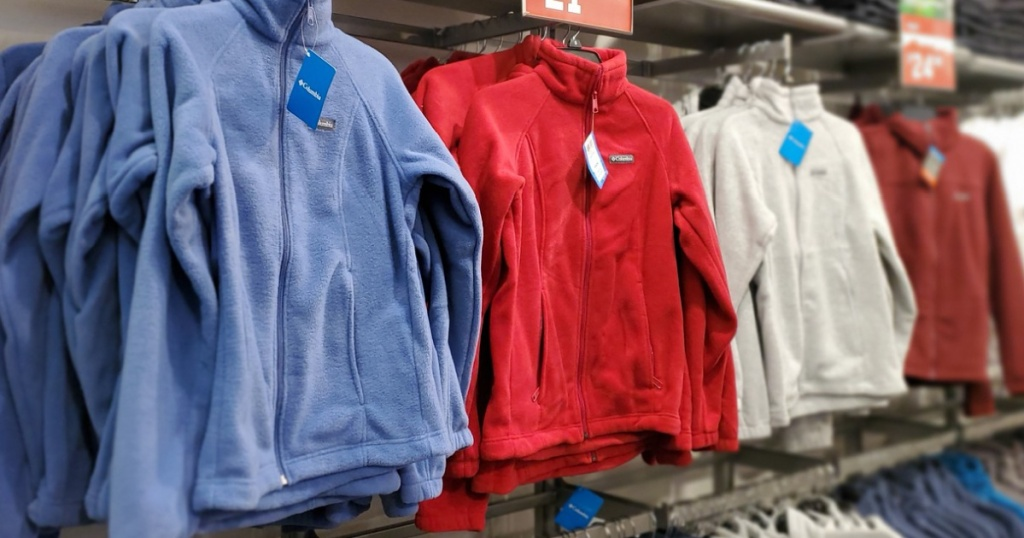 various colored fleece jackets hanging in store