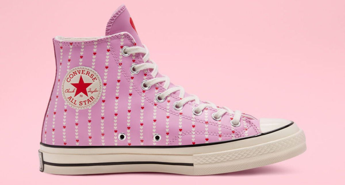 pink Converse shoes with hearts on them