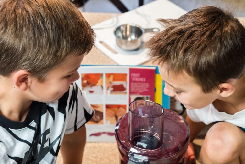 boys looking at a food processor